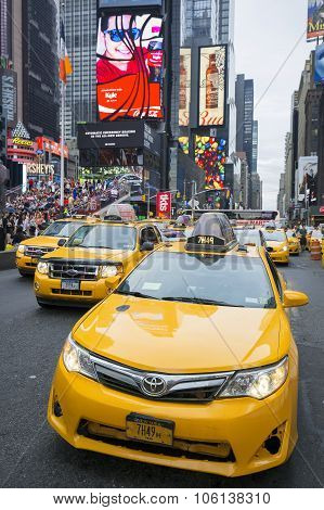 NEW YORK CITY - JULY 9: Taxi on Times Square an iconic street of New York City and America July 9 2015 in Manhattan New York City. Special photographic processing