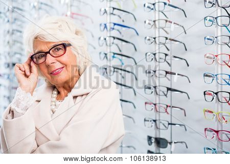 Portrait of senior woman in stylish eyeglasses poster