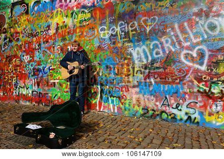 Busker by the John Lennon Wall in Prague