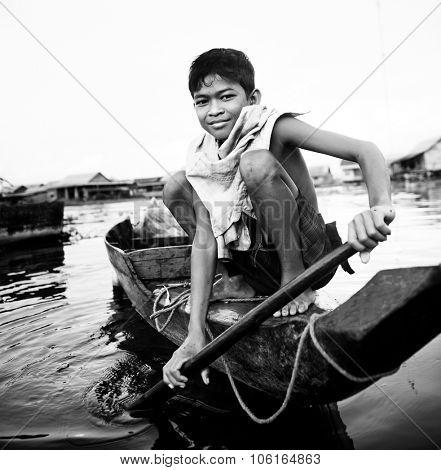 Boy Taveling Boat Floating Village Cambodian Vessel Concept poster