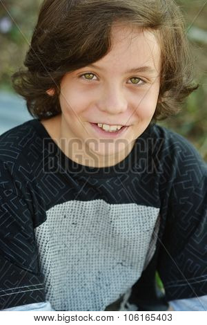 happy smiling preteen boy with long hair poster