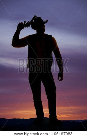 Silhouette Of A Cowboy With A Pistol By Head