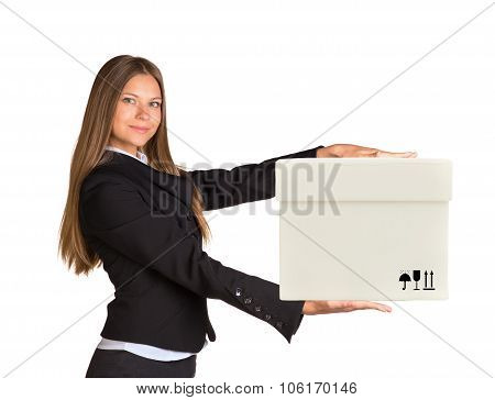 Businesslady holding box and looking at camera