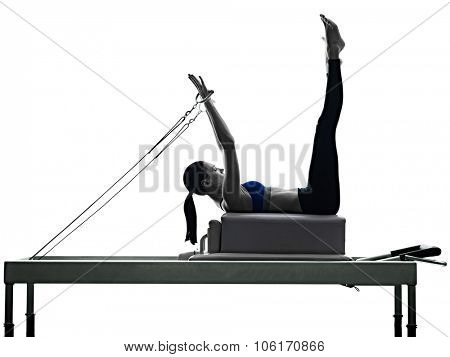 one caucasian woman exercising pilates reformer exercises fitness in silhouette isolated on white backgound poster
