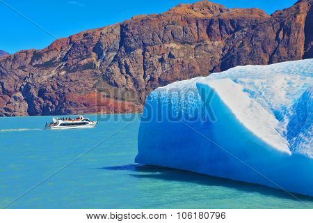 Ice and sun Patagonia, Argentina. Excursion on the tourist boat on Lake Viedma. White and blue huge icebergs floating near the ship broadside