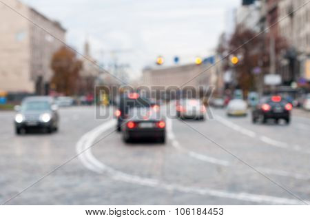 Blurred city road with light trafic. Urban background