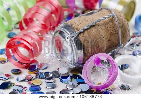 Confetti, Streamers And Champagne Cork On A White Background