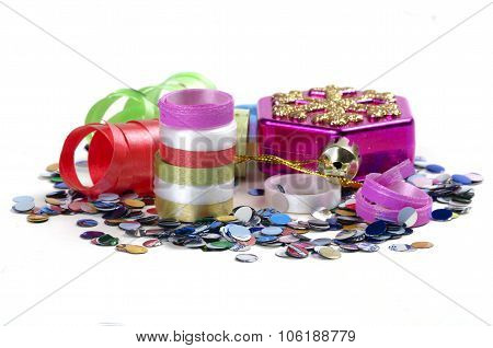 Confetti, Streamers And Christmas Tree Toy On A White Background