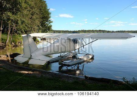 White Seaplane On The Lake Shore