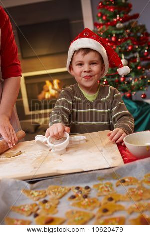 Little Boy Helping At Christmas