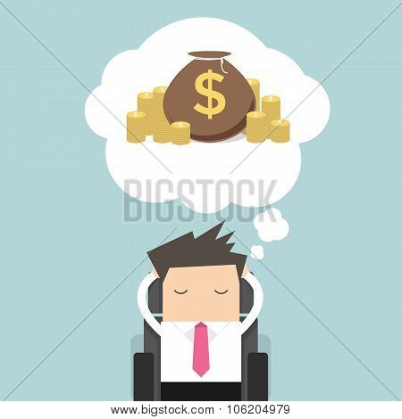 Business man dreaming about money