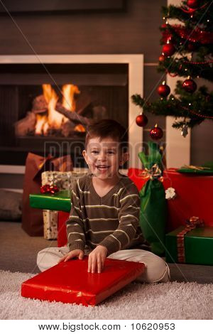 Little Boy Wrapping Out Christmas Present
