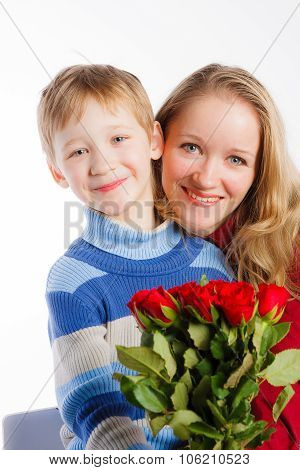Mother and her son with bouquet of flowers