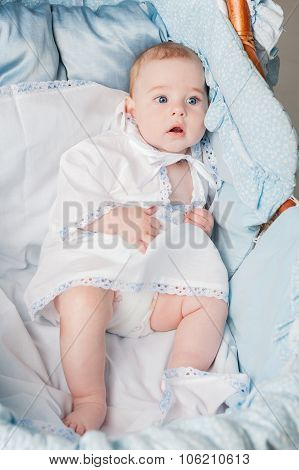 Nice little boy laying in cradle