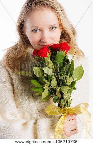 Charming woman holding nice bouquet of red roses