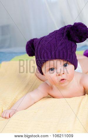 Cute little boy in funny purple hat