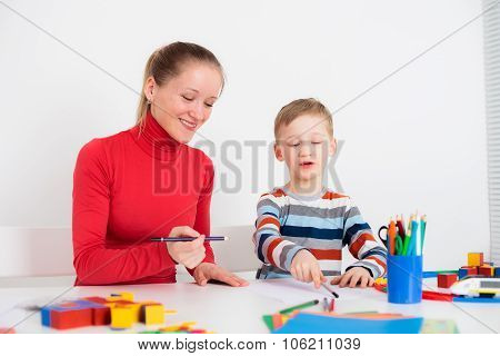 Son and his mom drawing together