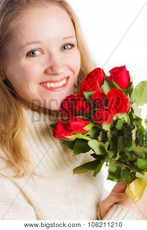 Close up of young woman with bouquet of red roses