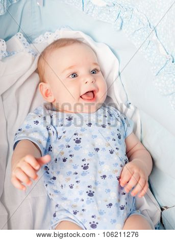 little boy in cradle