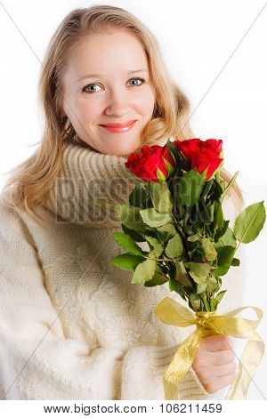 Charming woman holding bouquet of red roses