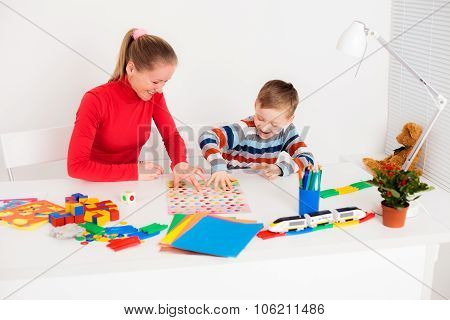 Mother playing with son in funny game