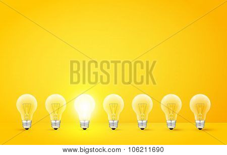Standing in a row light bulbs with glowing one on yellow background. Unlike others or odd man out co