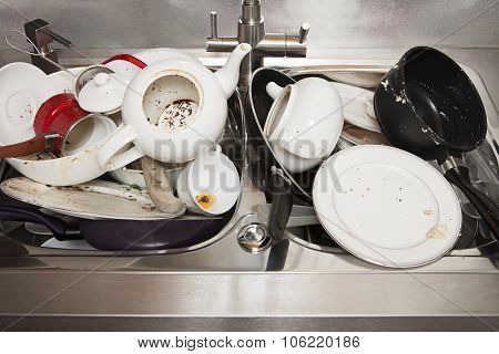 Dirty Dishes On Sink In The Kitchen