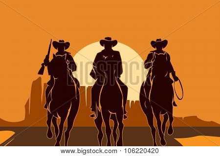 Cowboys riding horses in desert