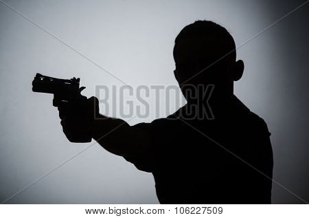 Shadow of the man with gun