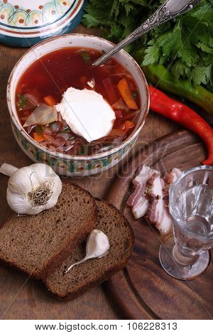 Borsch with sour cream vodka and salty fat with a meat layer poster