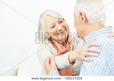 Two happy senior people in love looking at each other