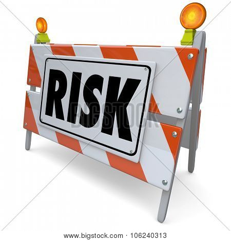 Risk word on a barrier, barricade or construction sign to illustrate danger, liability, hazard and warning poster