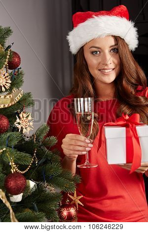 young woman by a christmastree