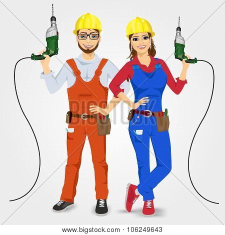 handyman and handywoman holding green drills