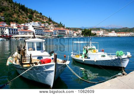 resting fishing boats at gythion harbour in greece poster