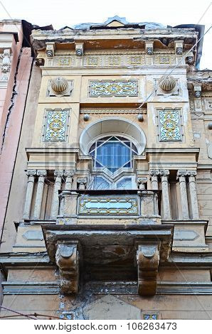 The Sculptural Patterned Facade With Balcony Of An Old Apartment Building In Tbilisi, Georgia
