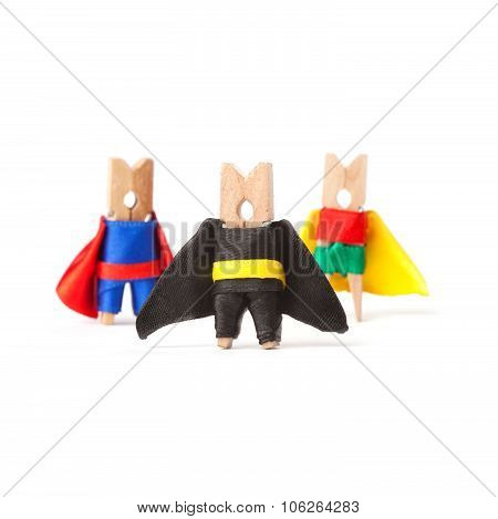 Team building, teamwork and leader concept. Superheroes clothespins. White background