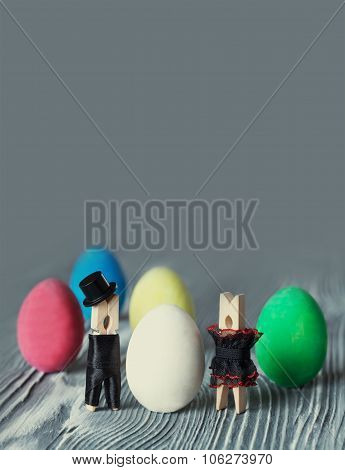 Surprise egg. Creative design easter card. Abstract love concept with clothespin heroes
