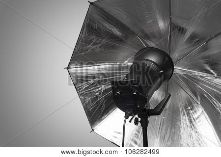 Photography Studio Strobe Flash With Silver Umbrella And Gray Copy Space