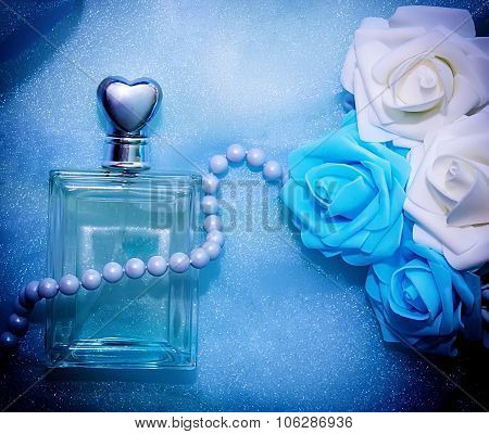 Perfume And Flowers In Blue Tone