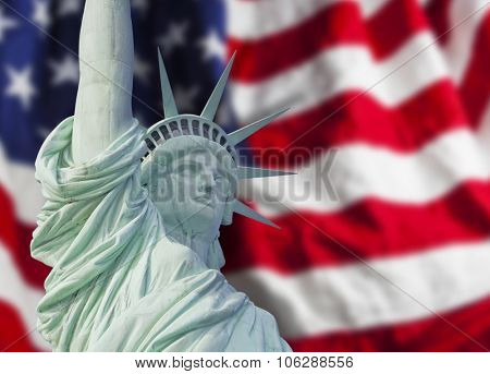 Statue of Liberty close up with shadow on American flag in New York City