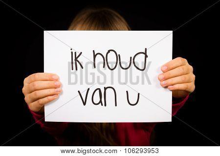 Child Holding Sign With Dutch Words Ik Houd Van U - I Love You