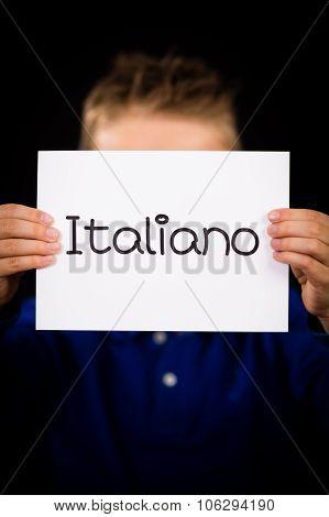 Child Holding Sign With Italian Word Italiano - Italian In English