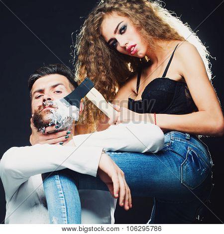 Woman Shaving Man