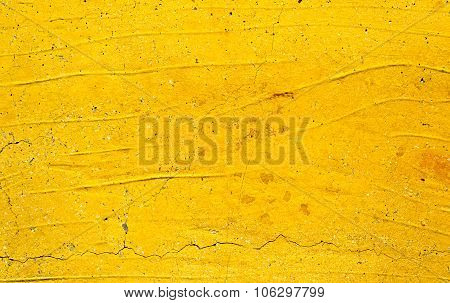 Yellow painted concrete wall texture