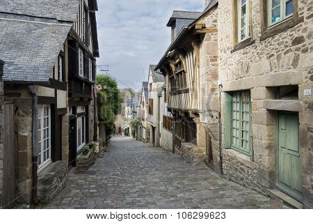 Medieval Cobbled Street In Dinan, Brittany, France