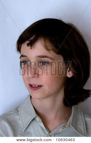 Portait Of Pensive Teenager Boy On Gray Background