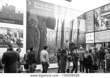 People queuing at the Truffle Fair of Alba. Black and white photo