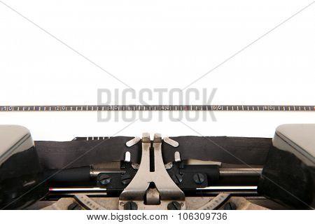 Detail old black typewriter with blank paper