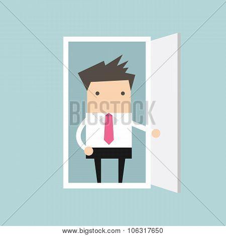 Businessman open the door